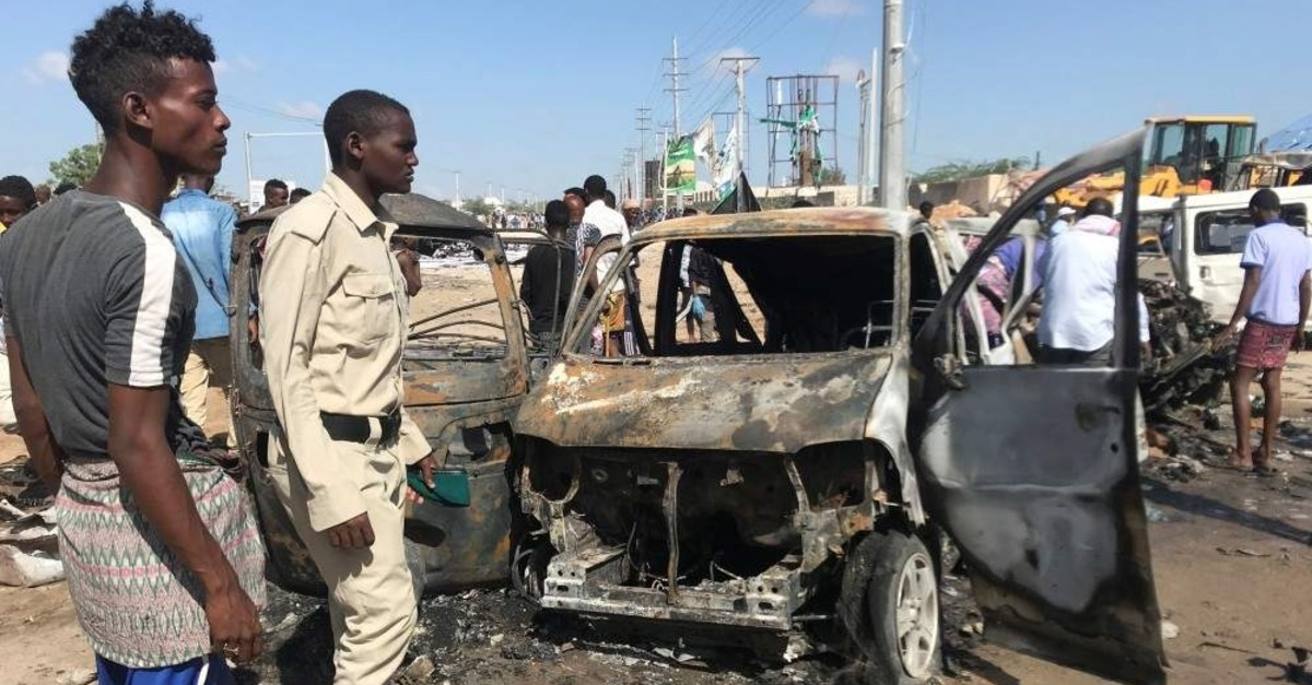 Somali security assess the scene of a car bomb explosion at a checkpoint in Mogadishu, Somalia, Dec. 28, 2019. (Reuters Photo)