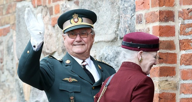 Danish Queen Margrethe II (R) and her husband Prince Henrik (L) arrive for a ceremony to mark the 150th anniversary of the Battle of Dybbol in Sonderborg, Denmark, April 18, 2014. (EPA Photo)