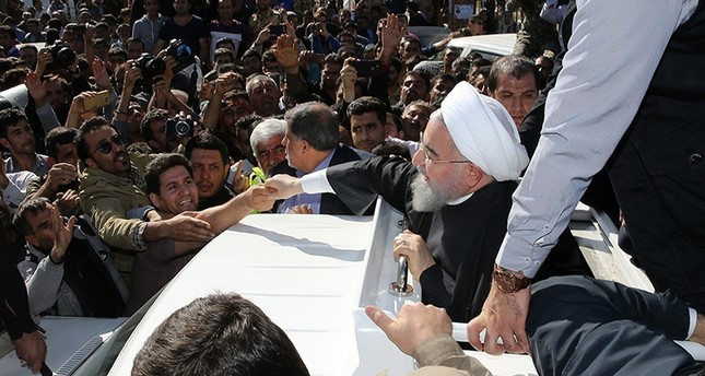 A handout photo provided by the office of Iranian President Hassan Rouhani shows him (C) during visit to the earthquake-hit area of Sarpol-e Zahab, Kermanshah province, Iran, Nov. 14, 2017. (via AFP)