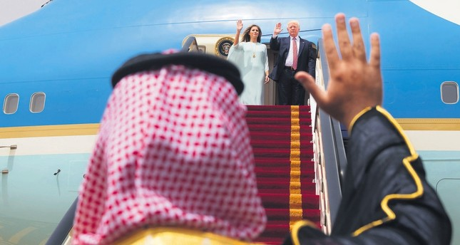 U.S. President Donald Trump and first lady Melania Trump wave as they board Air Force One before leaving Riyadh for Israel, May 22, 2017.