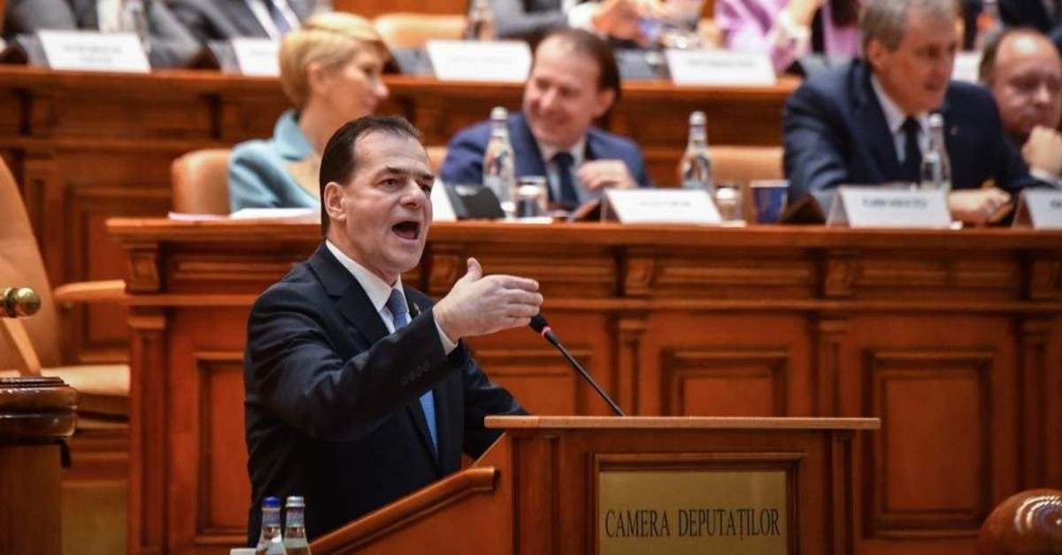 Romanian Prime Minister Ludovic Orban delivers his speech during a no-confidence vote at the Romanian Parliament, Bucharest, Feb. 5, 2020. (AFP Photo)