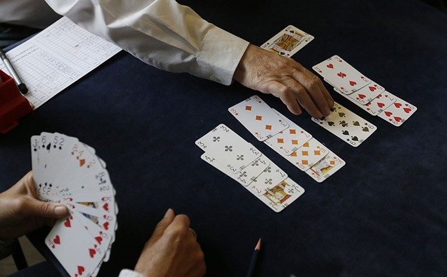 In this Sept. 22, 2015 file photo, competitors play bridge at the Acol Bridge Club in West Hampstead, London. (AP Photo)