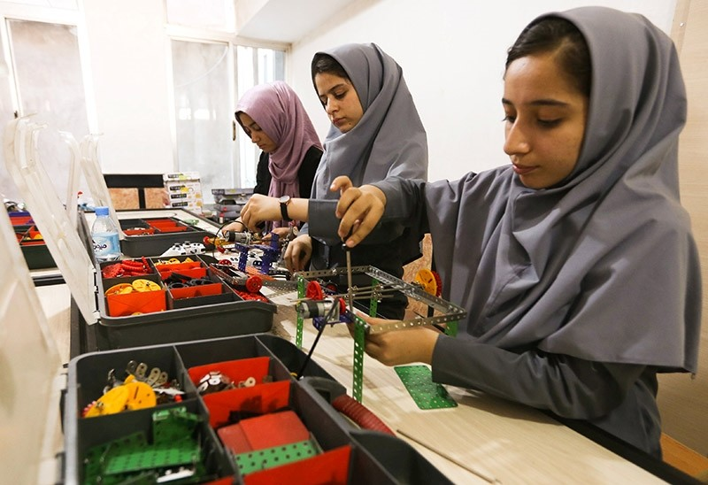 Members of Afghan robotics girls team which was denied entry into the United States for a competition, work on their robots in Herat province, Afghanistan July 4, 2017. (Reuters Photo)