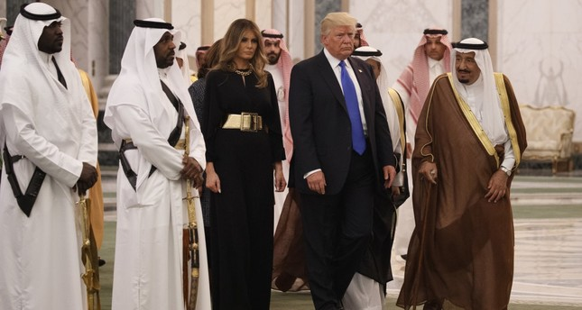 President Trump and first lady Melania Trump walk with Saudi King Salman to a presentation ceremony at the Royal Court Palace, Riyadh, May 20.