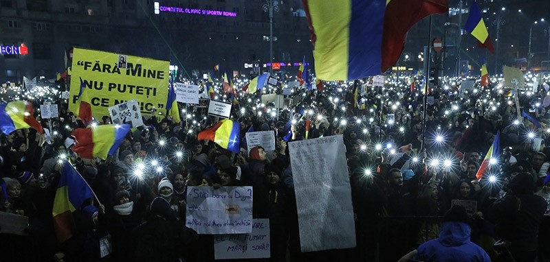 People switch on the lights on their mobile phones during a protest in front of government headquarters in Bucharest, Romania, 05 February 2017. (EPA Photo)
