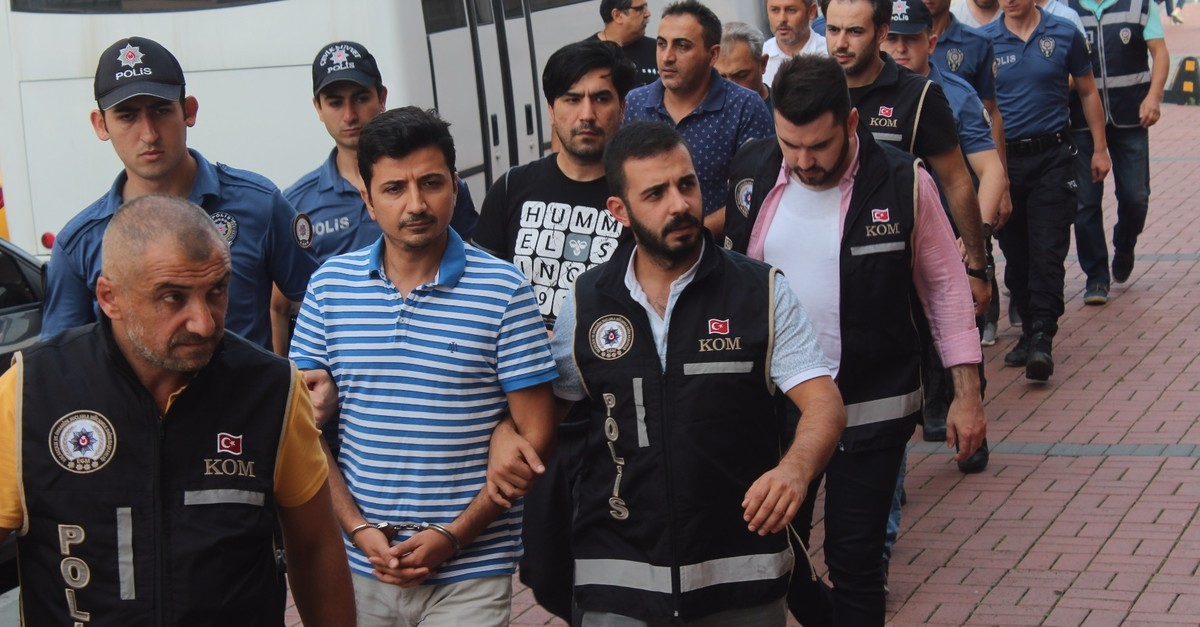 Thirteen suspects captured in operations against FETu00d6 are escorted to the courthouse by counterterrorism police in Kocaeli, Aug. 23, 2019.