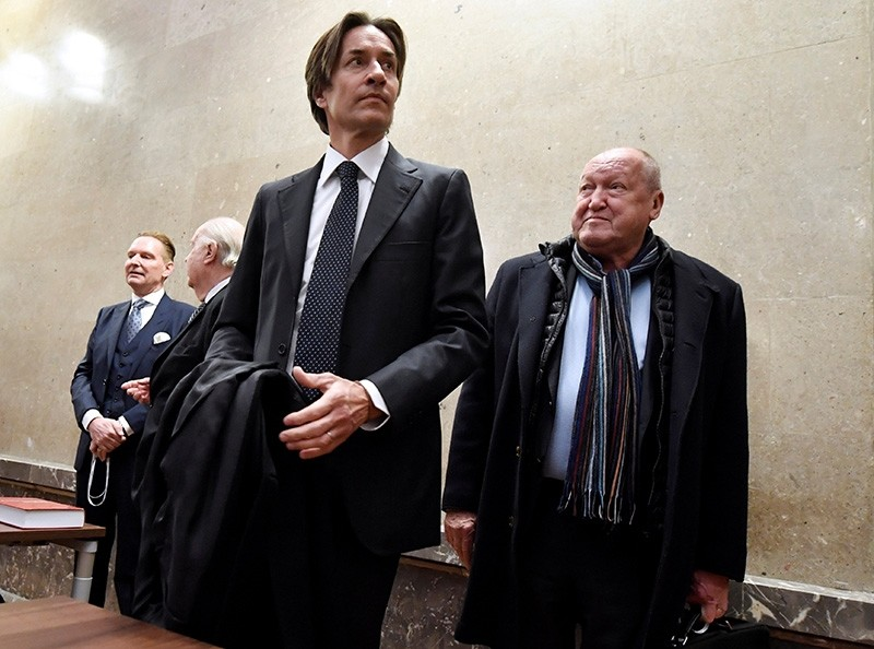 Former Austrian Finance Minister Karl-Heinz Grasser and Ernst Karl Plech arrive in the courtroom on the first day of his trial for embezzlement in Vienna, Austria, December 12, 2017. (Reuters Photo)