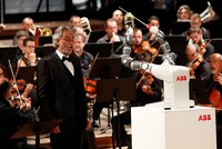 Italian tenor Andrea Bocelli's voice soars to the rafters of the Tuscan theater, but all eyes are on the orchestral conductor beside him -- a robot with an apparent penchant for Verdi.