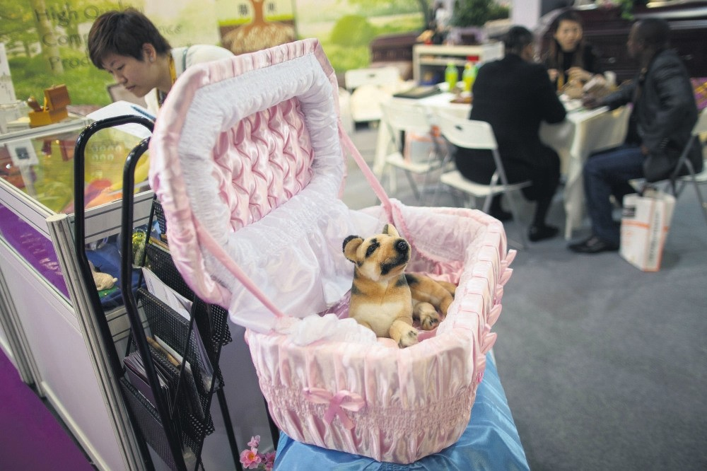 A coffin for infants and pets is displayed at an exhibitor booth during the 9th Asia Funeral Expo and Conference in Hong Kong, May 16. The three day event features over 100 exhibit booths from 18 countries.