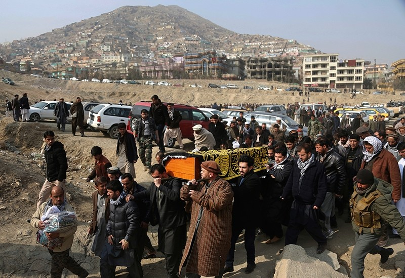 Mourners carry the coffin of a relative who died in a deadly attack a day earlier in Kabul, Afghanistan, Jan. 28, 2018. (AP Photo)