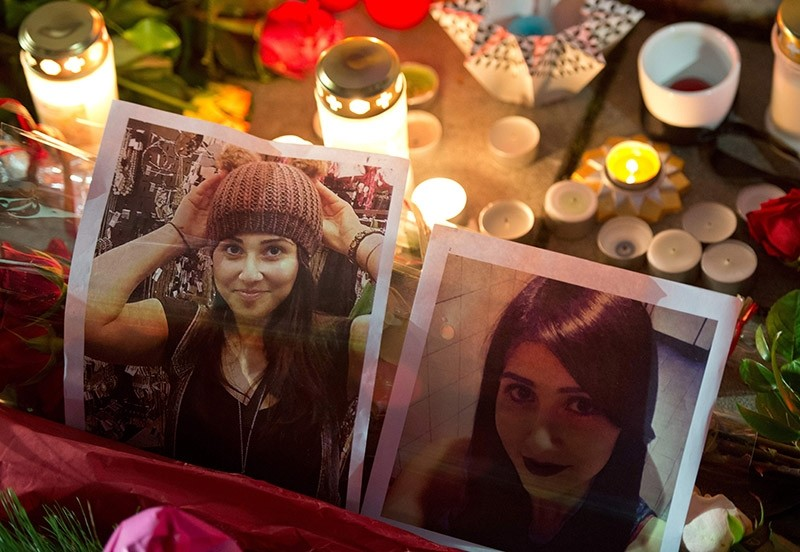 This file photo taken on November 28, 2014 shows candles placed by mourners around pictures of Tuu011fu00e7e Albayrak in front of a hospital in Offenbach, western Germany, where the young woman was getting medical treatment and where she died. (AFP Photo)
