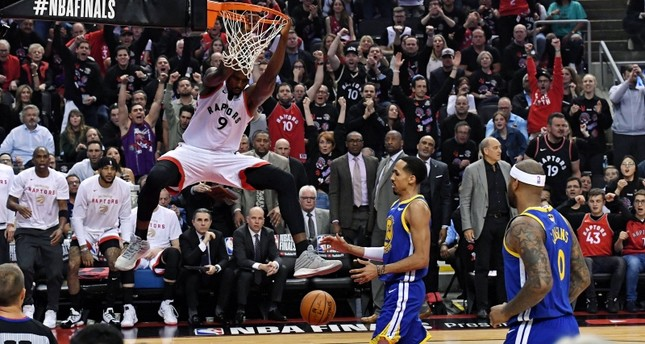 Toronto Raptors center Serge Ibaka 9 dunks the ball against Golden State Warriors guard Shaun Livingston 34 in game one of the 2019 NBA Finals at Scotiabank Arena. Reuters Photo
