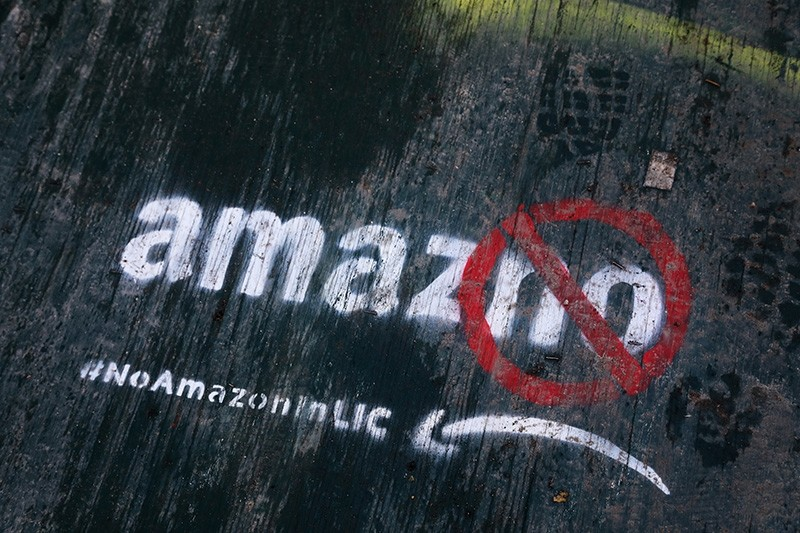 In this Nov. 16, 2018, file photo graffiti has been painted on a sidewalk by someone opposed to the location of an Amazon headquarters in the Long Island City neighborhood in the Queens borough of New York. (AP Photo)