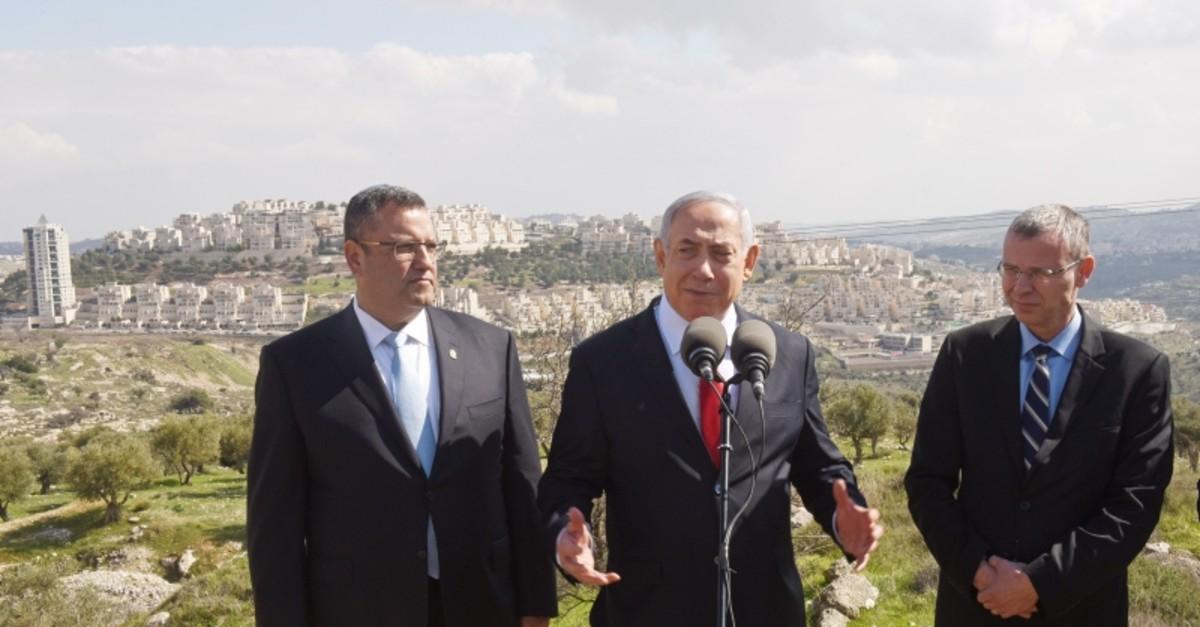 Israeli Prime Minister Benjamin Netanyahu delivers a statement overlooking the Israeli settlement of Har Homa (Reuters Photo)