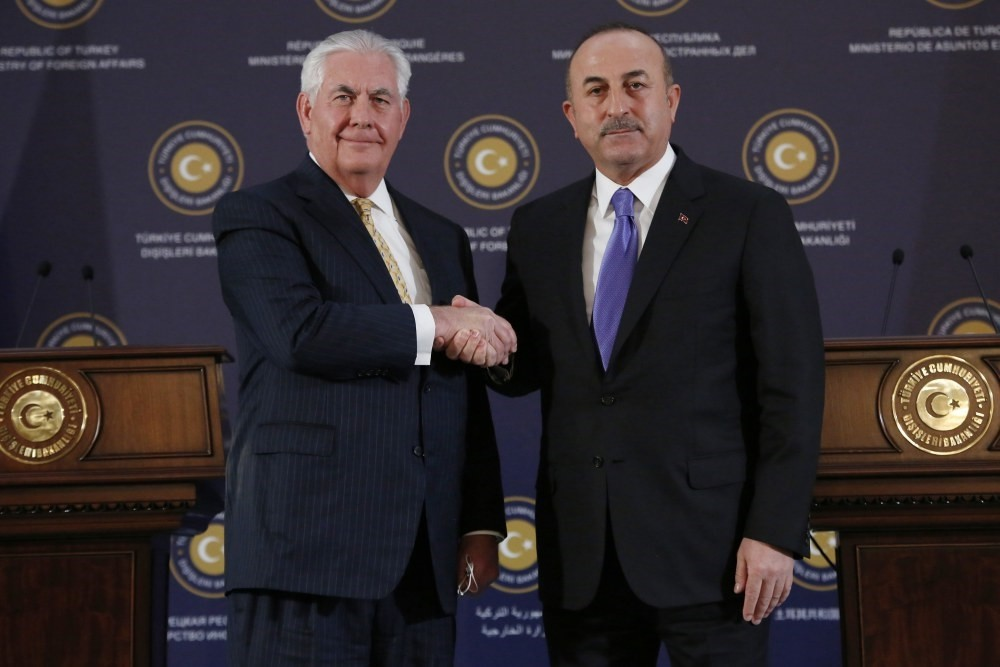 U.S. Secretary of State Rex Tillerson (L) shakes hands with the Foreign Minister Mevlu00fct u00c7avuu015fou011flu after their press conference in Ankara, Feb. 16, 2018. (EPA Photo)
