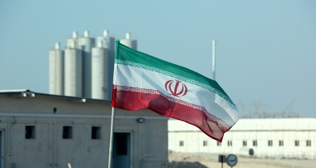In this file photo taken on November 10, 2019 an Iranian flag flutters in Iran's Bushehr nuclear power plant, during an official ceremony to kick-start works on a second reactor at the facility. AFP Photo