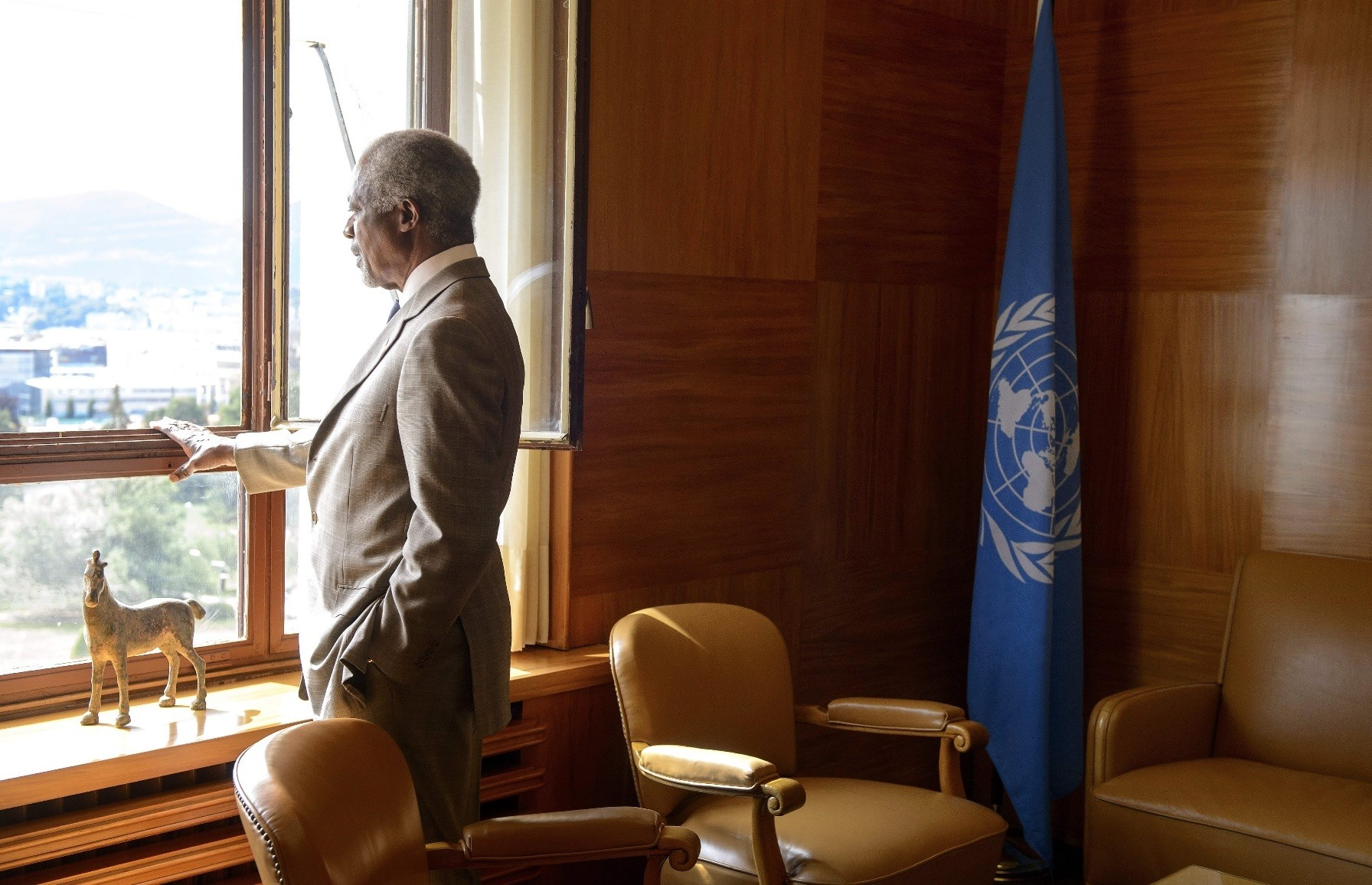 Late U.N. Secretary-General Kofi Annan gazes through a window before a meeting at his office in Geneva, July 20, 2012.