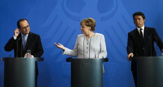 Hollande (L), Merkel (C) and Renzi