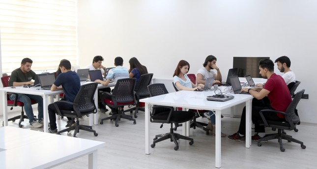 Young engineers working at Cumhuriyet University's technology innovation center in the Central Anatolian province of Sivas, developing software for local and international customers.