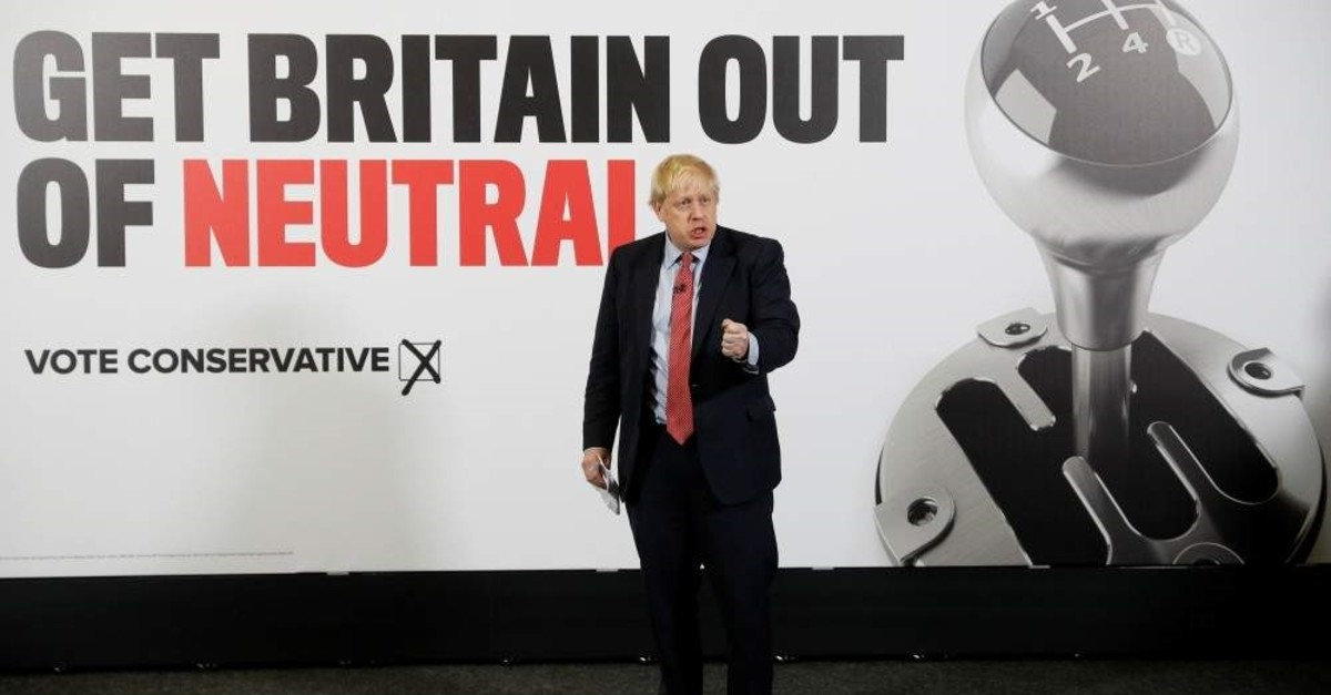 Britain's Prime Minister Boris Johnson gestures during the launch of a general campaign poster, Detling, Dec. 6, 2019. (REUTERS Photo)
