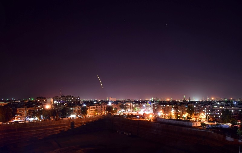 A handout picture released by SANA on September 15, 2018, reportedly shows Syrian air defense batteries responding to what the regime media said were Israeli missiles targeting Damascus international airport. (AFP Photo)