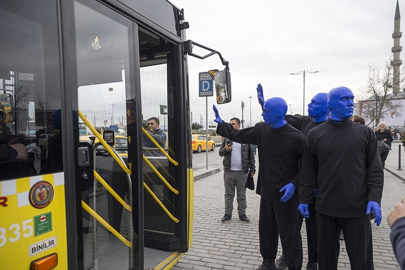 Blue Man Group waves to Istanbul's public transportation users
