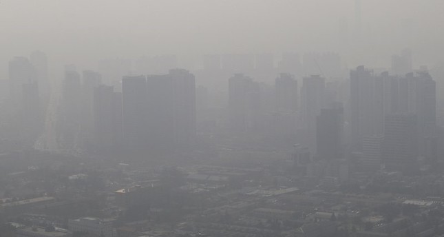 In this Feb. 26, 2014 file photo, buildings and houses are covered with a thick haze in Seoul, South Korea. South Korea's rapidly worsening air pollution has forced the country's professional baseball league to postpone three games. (AP Photo)