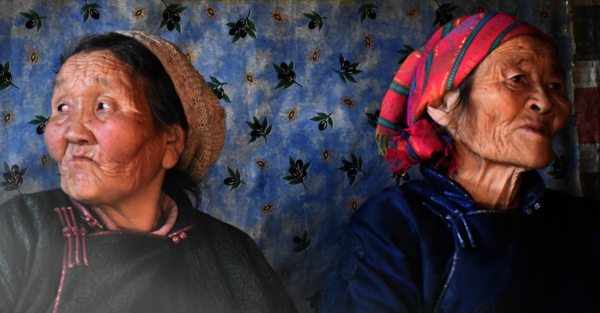 Two elderly Dukha Turks in their traditional clothing.