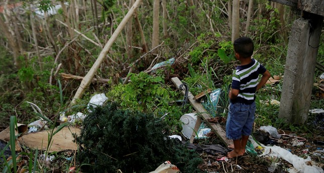Yadriel Manuel, 6, looks outside a home damaged by Hurricane Maria in the Trujillo Alto municipality outside San Juan, Puerto Rico, October 9, 2017. (Reuters Photo)