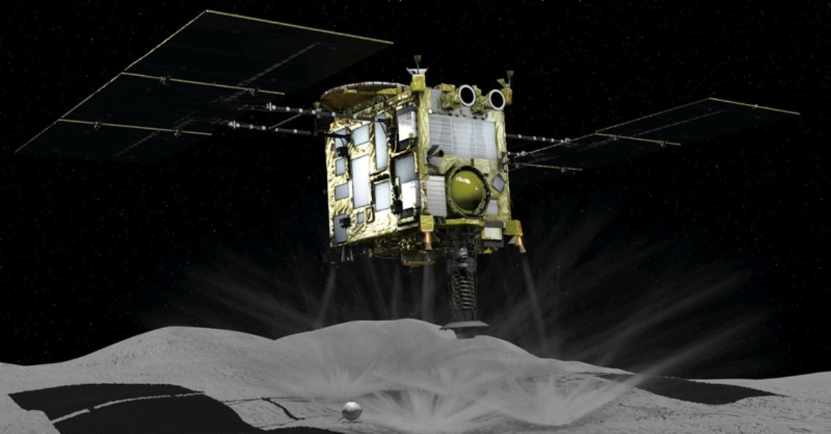 A computer graphic handout image shows Japan Aerospace Exploration Agency's Hayabusa 2 probe touches down on an asteroid, in this image released by Japan Aerospace Exploration Agency and obtained by Reuters on February 22, 2019.