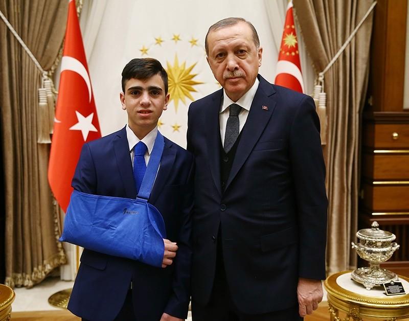 President Recep Tayyip Erdou011fan receives iconic Palestinian teenager Fawzi al-Juneidi on Jan. 18, 2018. (AA Photo)