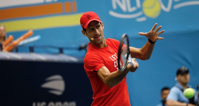 Serbian tennis player Novak Djokovic participates at the '2018 Arthur Ashe Kids Day' at the 2018 U.S. Open Tennis Championships at the USTA National Tennis Center in Flushing Meadows, New York, Aug. 25.