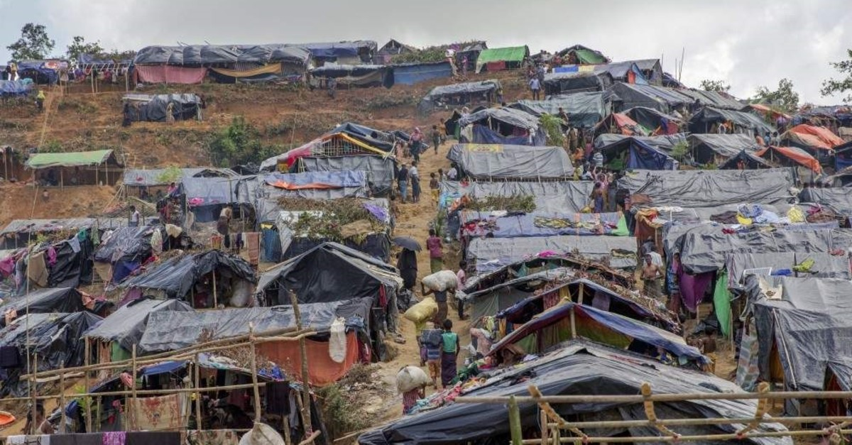 In this Friday, Sept. 22, 2017 file photo, newly set up tents cover a hillock at a refugee camp for Rohingya Muslims who crossed over from Myanmar into Bangladesh, in Taiy Khali, Bangladesh. (AP Photo)