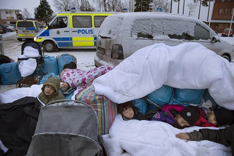 In this Jan. 8, 2016 file photo, migrant children Nor, Saleh and Hajaj Fatema from Syria sleep outside the Swedish Migration Board,  in Marsta, Sweden. (AP Photo)