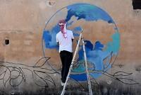 Turkish graffiti artists create anti-war murals in Syria