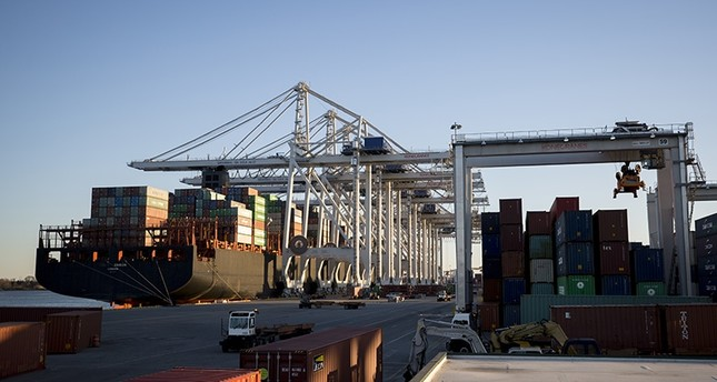 In this Jan. 30, 2018, file photo, several ship to shore cranes work a vessel at the Georgia Ports Authority's Port of Savannah loading and unloading container in Savannah, Ga. (AP Photo)