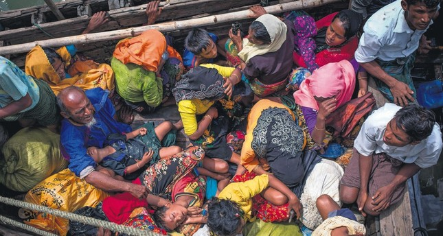Rohingya refugees arriving by boat at Shah Parir Dwip on the Bangladesh side of the Naf River on Sept. 12.