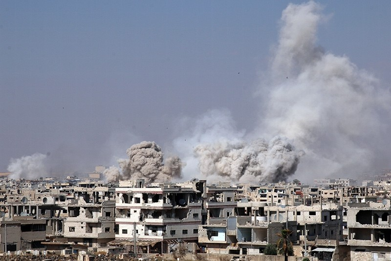Smoke rises after shelling on an opposition-held area of Deraa, Syria, June 4, 2017 (Reuters Photo)