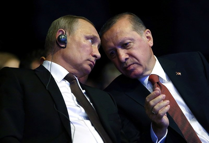 Turkish President Recep Tayyip Erdou011fan (R) talking with his Russian counterpart Vladimir Putin during the opening ceremony of the 23rd World Energy Congress in Istanbul, Turkey.