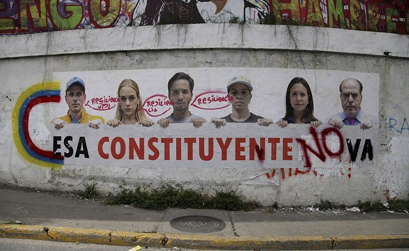 A poster that shows some of Venezuela's opposition leaders holding a sign with a message that reads in Spanish: ,That constituent assembly will not pass, is displayed on a wall near Altamira Square in Caracas, Venezuela, Aug. 3, 2017. (AP Photo)
