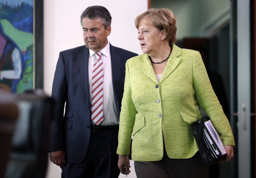German Chancellor Angela Merkel and German Foreign Minister Sigmar Gabriel arrive for the weekly cabinet meeting at the chancellery in Berlin, Germany, June 14.