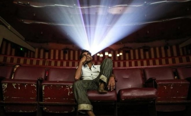 A cinema goer watches a Bollywood movie. (REUTERS Photo)