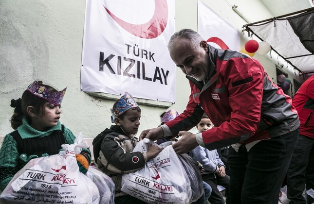 Turkish Red Crescent President Dr. Kerem Kınık delivers toys, clothes and stationery to children in Idlib, Syria.