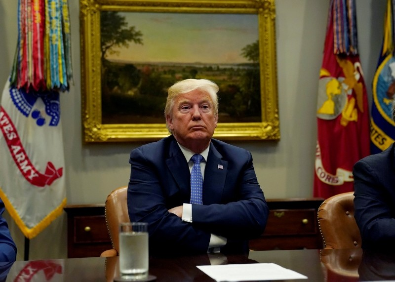 U.S. President Donald Trump looks up while holding a roundtable on the Foreign Investment Risk Review Modernization Act at the White House in Washington, U.S., August 23, 2018. (Reuters Photo)
