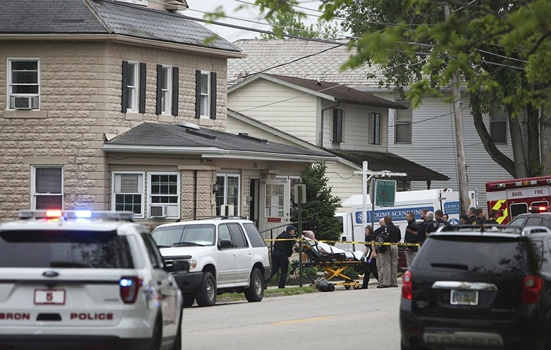 A person is removed from the Pine Kirk nursing home in Kirkersville, Ohio on Friday, May 12, 2017. (AP Photo)