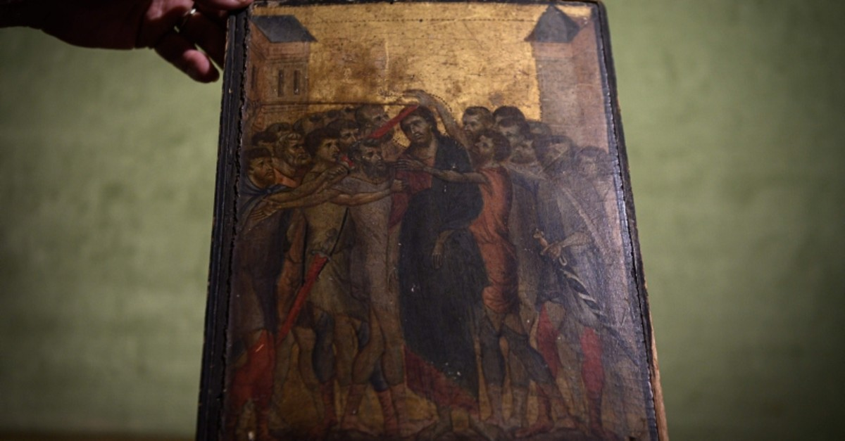 This photo taken on September 23, 2019 in Paris shows a painting entitled ,the Mocking of Christ, by the late 13th century Florentine artist Cenni di Pepo also known as Cimabue (AFP Photo)