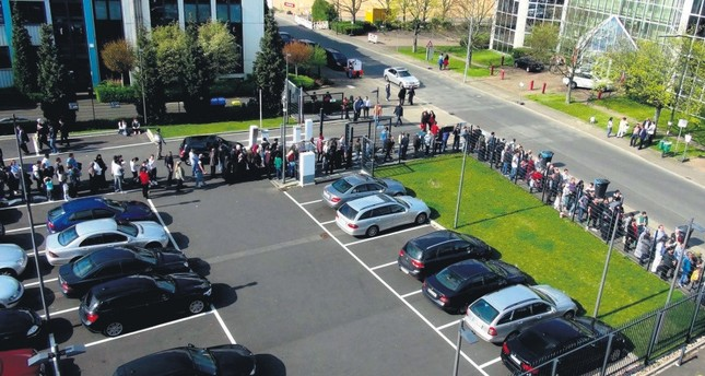 Turkish voters seen in Germany's Düsseldorf formed long lines to vote at the ballot boxes over the weekend.