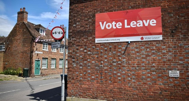 A 'Vote Leave' sign is seen on the side of a building in Charing on June 16, 2016 urging people to vote for Brexit in the upcoming EU referendum.