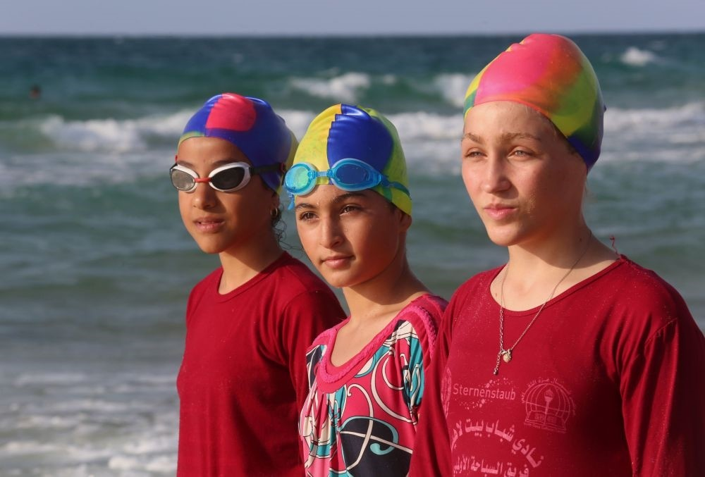 Young Palestinian members of a swimming club prepare to swim during a training session in Beit Lahia in the northern Gaza Strip, Oct. 4.