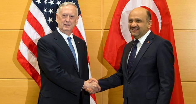 U.S. Secretary of Defense James Mattis L shakes hands with Turkish Defense Minister Fikri Isik during a meeting at NATO headquarters. AFP Photo